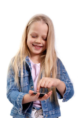 little girl with a touchscreen smart phone photo