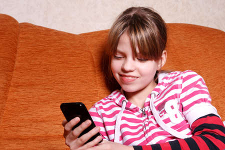 girl play games on her Touchscreen Phone photo