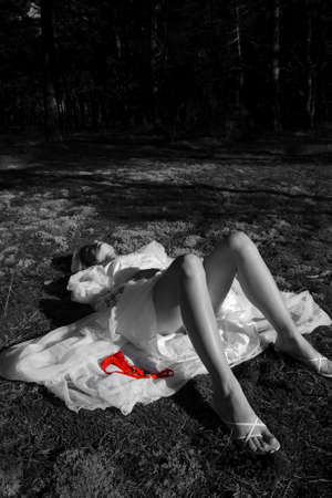 Girl lying in the forest photo