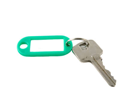 keyholder: plastic keyholder with key on white background