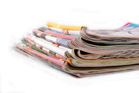a stack of old magazines on white background
