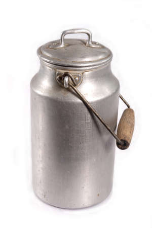 canister: old aluminum milk canister on white background Stock Photo
