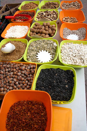 Variety of nuts on street market. photo