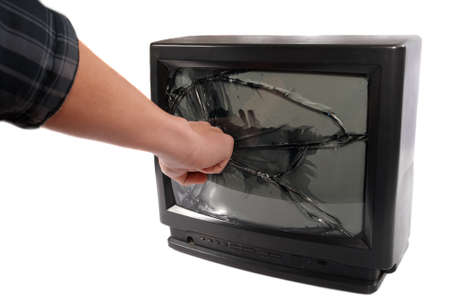 trashed: Turn off your TV. Kill it.mans hand punching TV screen Stock Photo