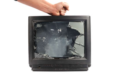 Turn off your TV. Kill it.mans hand punching TV  Stock Photo