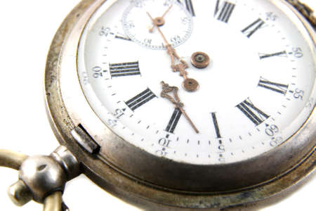 old broken pocket watch on white background