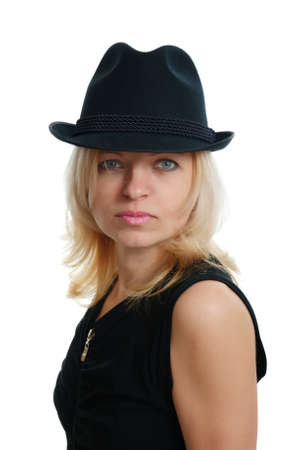 serious woman with a black hat on white background photo