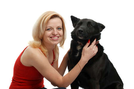 smiling woman with a dog on a white background