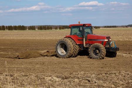 Agriculture.  tractor plowing the fields photo
