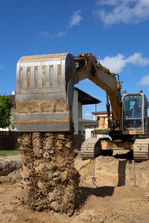 excavator loader machine during earthmoving works outdoors at construction site Stock Photo - 13746247