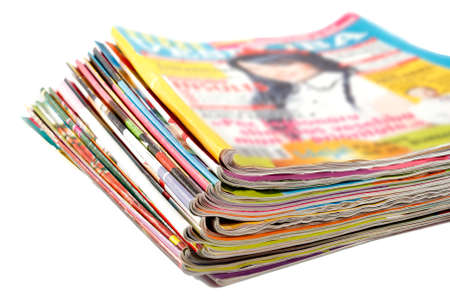stack of old colored magazines on a white background Stock Photo
