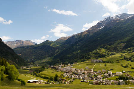 Traditional Swiss Alps mountain landscape with small village Stock Photo - 14000698