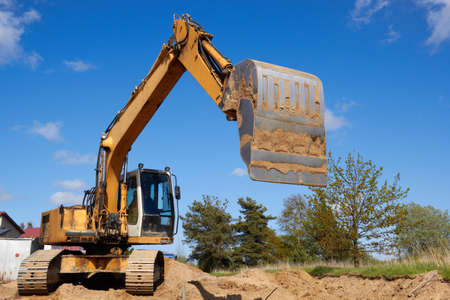 excavator working on a construction site, construction of new streets Stock Photo - 14036753
