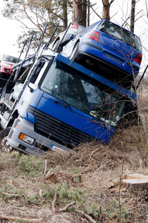 car crash, truck trailer with cars in the ditch Stock Photo - 14120521