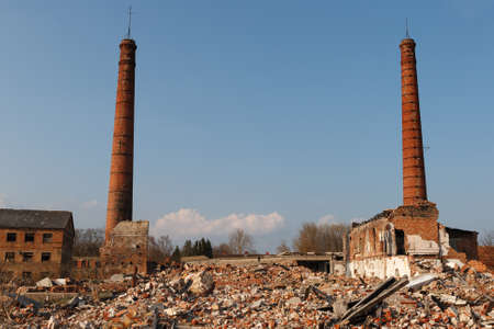 abandoned factory: abandoned factory with two smokestacks