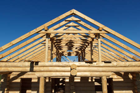 Structure of a wooden house under construction photo