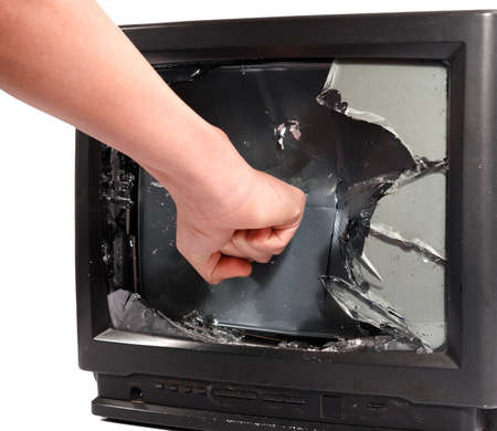mans hand crush old television screen