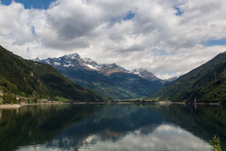Lago di Poschiavo is a natural lake in the Poschiavo valley in the canton of Grisons, Switzerland. Stock Photo - 14349242