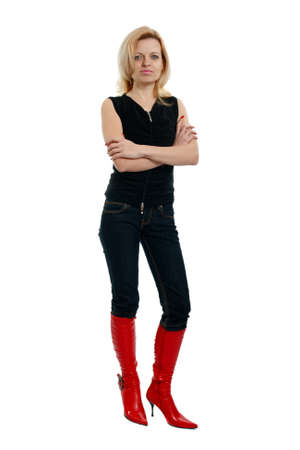 woman in red boots and a black shirt on a white background photo