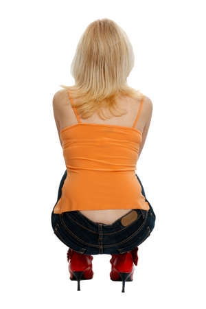 crouching: squatting woman from behind on white background