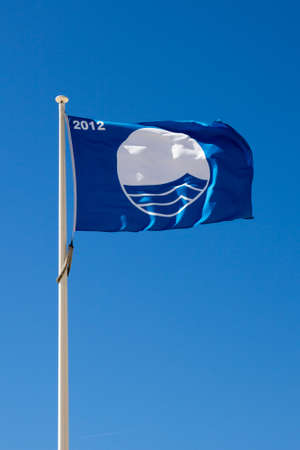stringent: The Blue Flag is a certification by the Foundation for Environmental Education that a beach or marina meets its stringent standards.
