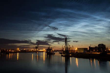 Silver clouds. Noctilucent clouds are bright cloudlike atmospheric phenomena visible in a deep twilight. They are the highest clouds in the Earths atmosphere. photo