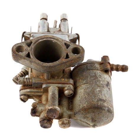 dirty old motorcycle carburetor on a white background