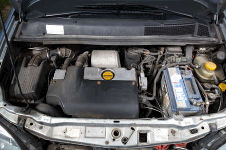 open car hood and old turbo diesel engine photo