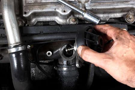 car repair, repairing diesel engine, EGR valve change photo
