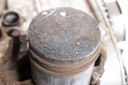 close up of old dirty engine piston