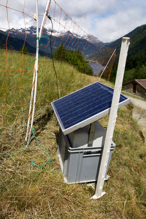 solar panel powered electric shepherd in the Swiss Alps Stock Photo - 14650048