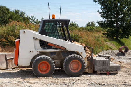 small excavator at construction site Stock Photo - 14759550