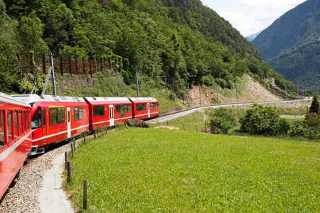 Swiss mountain train Bernina Express  crossed Alps via Bernina Pass photo