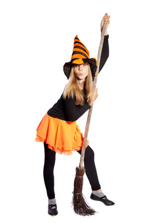 witch with a hat and broom standing on white background photo