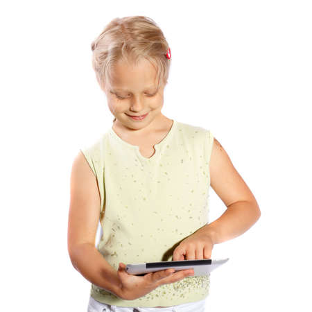 girl playing with his Tablet PC on a white background photo