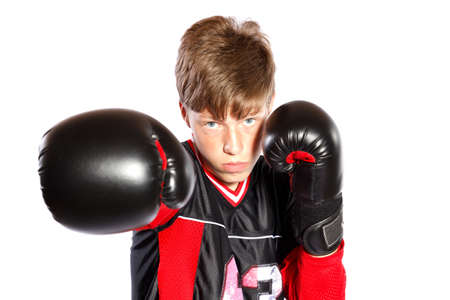 young kickboxer on white background, focus on face photo