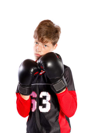 young kickboxer on white background photo