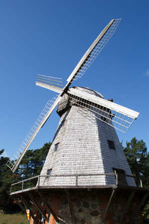 old traditional windmill against a blue sky