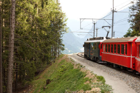 Swiss mountain train Bernina Express  crossed Alps via Bernina Pass Stock Photo - 15481216
