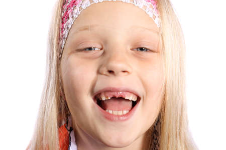 Portrait of smiling, cute, little girl with blond hair and missing front milk teeth. photo