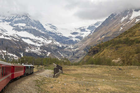 Swiss mountain train Bernina Express  crossed Alps via Bernina Pass Stock Photo - 15931535
