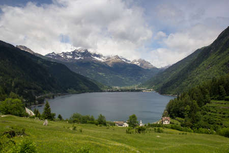 Lago di Poschiavo is a natural lake in the Poschiavo valley in the canton of Grisons, Switzerland Alps.  Stock Photo - 16135027
