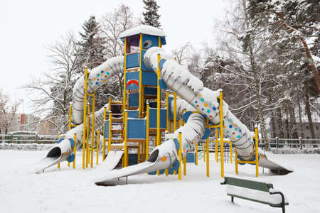 snowy slides in childrens playground park after the snow storm photo