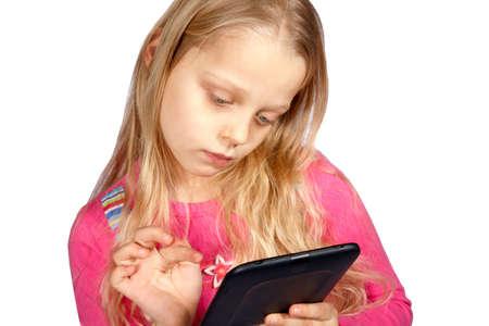 little girl using ebook reader or digital tablet computer
