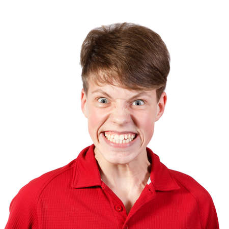 boy in red shirt with a big smile and wide eyes  photo