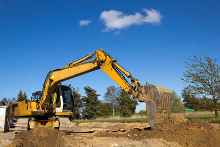 excavator working on a construction site photo