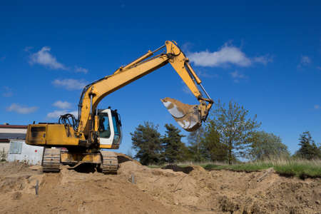big yellow excavators working on a construction site Stock Photo - 18263129