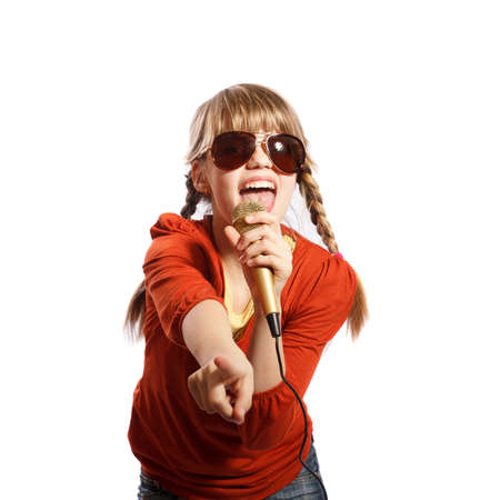 Girl singing into a microphone on a white background Stock Photo