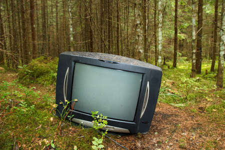Discarded television set in the forest photo
