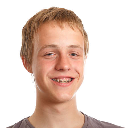 teen boy face: smiling teenager with dental braces on a white background
